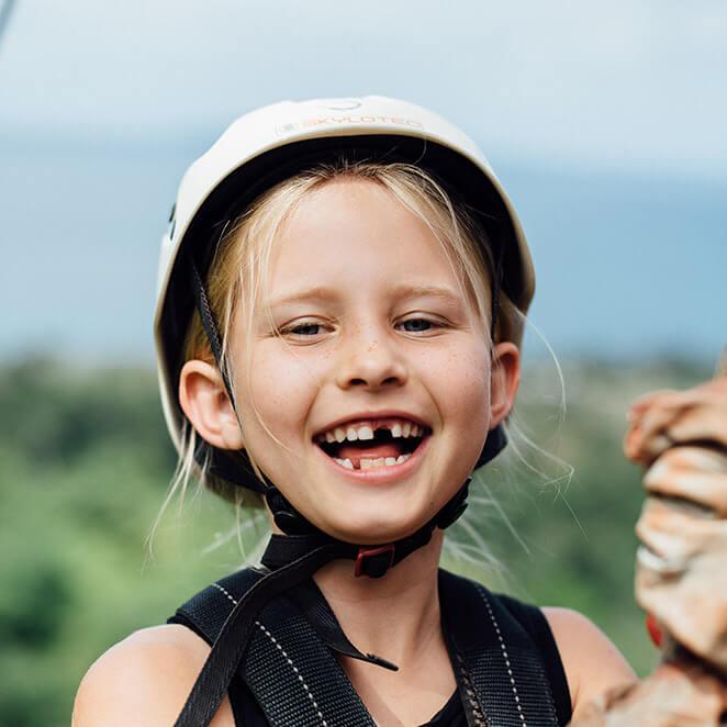 smiling-young-girl-on-zipline